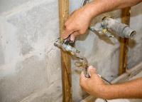 Plumber Repairing A Pipe